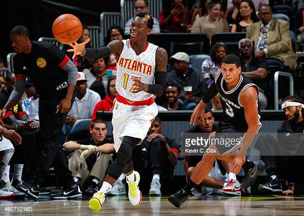 Dennis Schroder of the Atlanta Hawks prepares to catch a pass against Ray McCallum of the San Antonio Spurs at Philips Arena on October 14 2015 in...