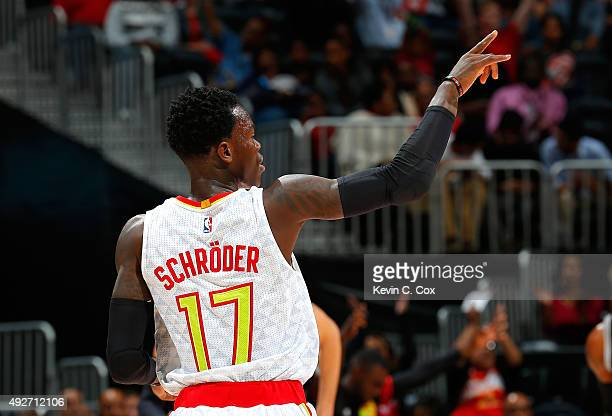 Dennis Schroder of the Atlanta Hawks reacts after a basket against the San Antonio Spurs at Philips Arena on October 14 2015 in Atlanta Georgia NOTE...