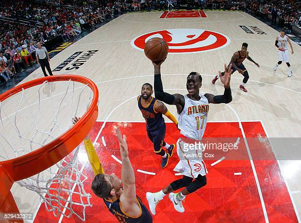 Dennis Schroder of the Atlanta Hawks shoots against Matthew Dellavedova of the Cleveland Cavaliers in Game Four of the Eastern Conference Semifinals...