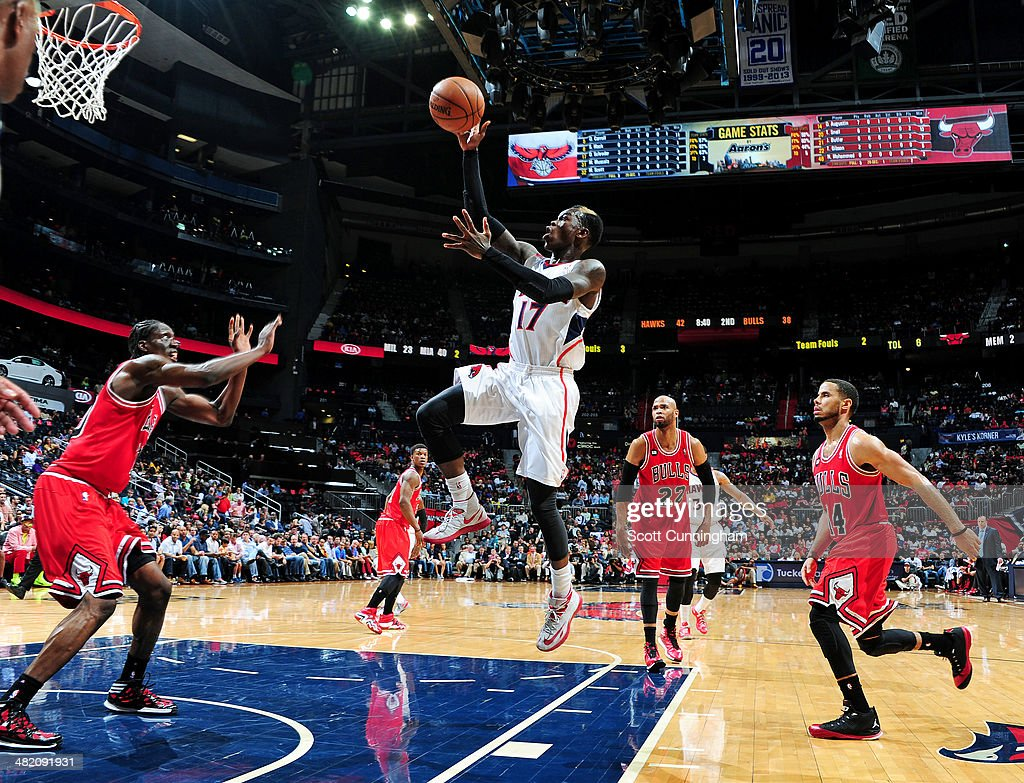 Dennis Schroder #17 of the Atlanta Hawks shoots against the Chicago Bulls on April 2, 2014 at Philips Arena in Atlanta, Georgia.