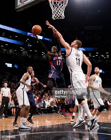 Dennis Schroder of the Atlanta Hawks shoots the ball against Brook Lopez of the Brooklyn Nets in Game Six of the Eastern Conference Quarterfinals...