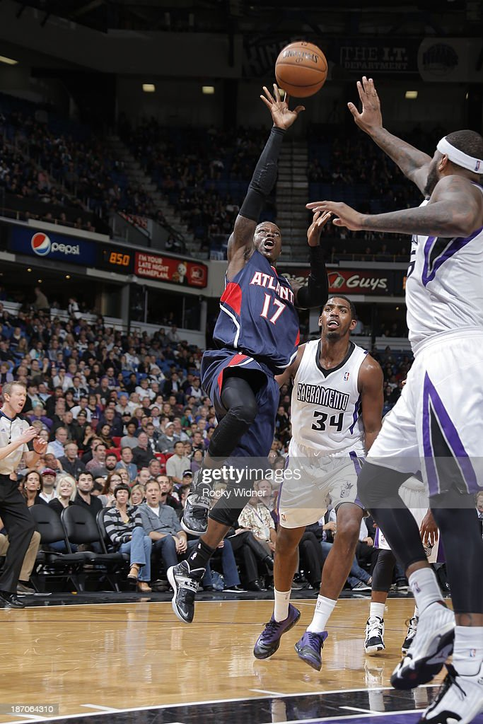 Dennis Schroder #17 of the Atlanta Hawks shoots the ball against DeMarcus Cousins #15 of the Sacramento Kings at Sleep Train Arena on November 5, 2013 in Sacramento, California.