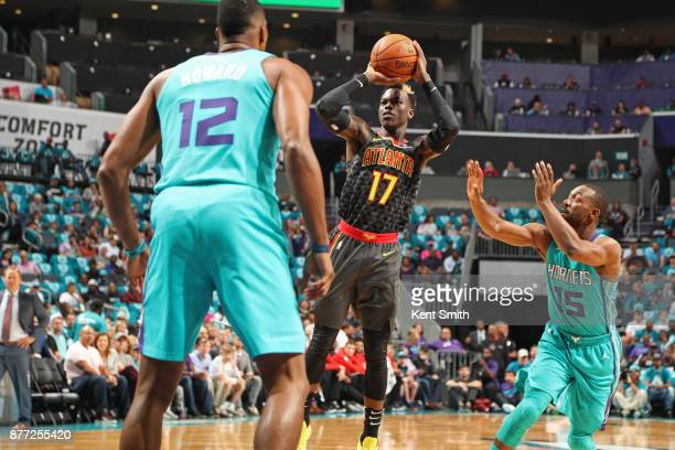 Dennis Schroder of the Atlanta Hawks shoots the ball against the Charlotte Hornets on October 20 2017 at Spectrum Center in Charlotte North Carolina...