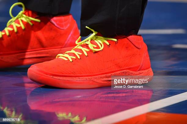Dennis Schroder of the Atlanta Hawks showcases his sneakers against the New York Knicks at Madison Square Garden on December 10 2017 in New York New...