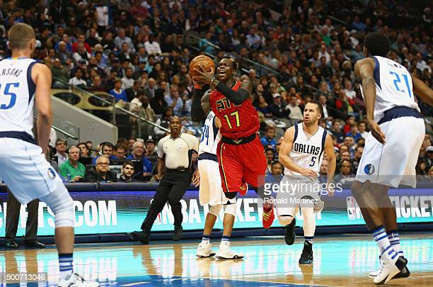Dennis Schroder of the Atlanta Hawks takes a shot against the Dallas Mavericks at American Airlines Center on December 9 2015 in Dallas Texas NOTE TO...