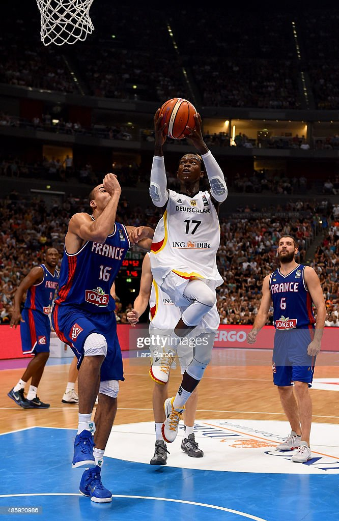 Dennis Schroeder of Germany is challenged by <a gi-track='captionPersonalityLinkClicked' href=/galleries/search?phrase=Rudy+Gobert&family=editorial&specificpeople=7616046 ng-click='$event.stopPropagation()'>Rudy Gobert</a> of France during the Men's Basketball friendly match between Germany and France at Lanxess Arena on August 30, 2015 in Cologne, Germany.