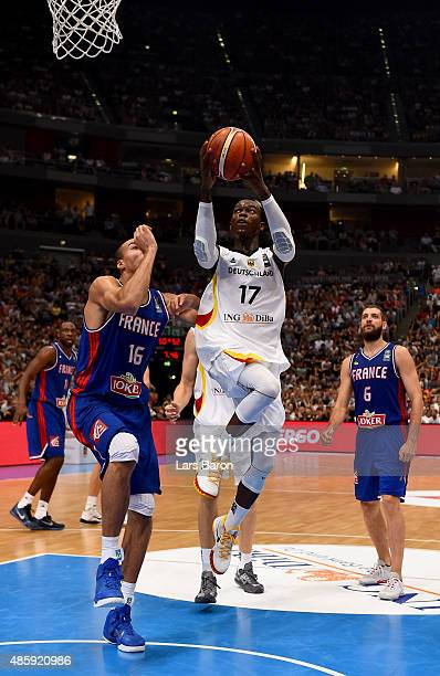 Dennis Schroeder of Germany is challenged by Rudy Gobert of France during the Men's Basketball friendly match between Germany and France at Lanxess...