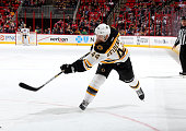 Dennis Seideberg of the Boston Bruins fires a shot on goal during their NHL game against the Carolina Hurricanes at PNC Arena on March 29 2015 in...