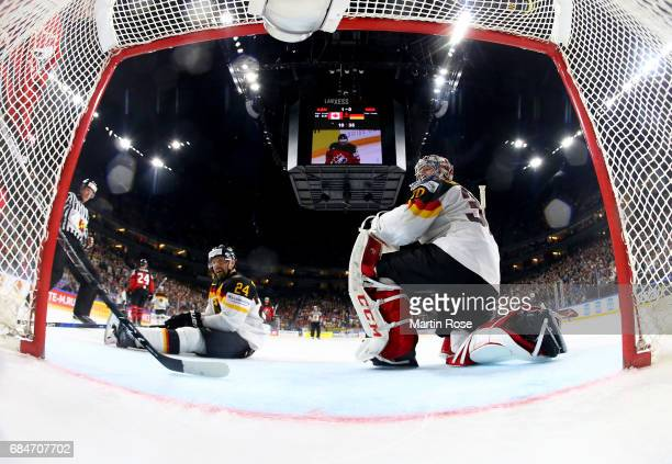 Dennis Seidenberg and Philipp Grubauer of Germany look dejected during the 2017 IIHF Ice Hockey World Championship quarter final game between Canada...