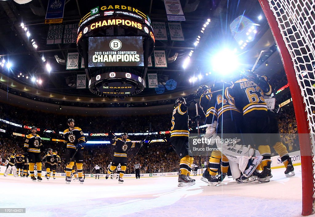 Dennis Seidenberg #44 and Tuukka Rask #40 of the Boston Bruins celebrate with teammates after defeating the Pittsburgh Penguins 1-0 in Game Four of the Eastern Conference Final during the 2013 Stanley Cup Playoffs at TD Garden on June 7, 2013 in Boston, Massachusetts.