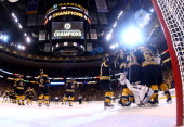 Dennis Seidenberg and Tuukka Rask of the Boston Bruins celebrate with teammates after defeating the Pittsburgh Penguins 10 in Game Four of the...