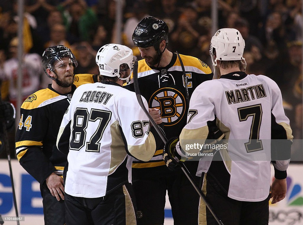 Dennis Seidenberg #44 and Zdeno Chara #33 of the Boston Bruins shake hands with Sidney Crosby #87 and Paul Martin #7 of the Pittsburgh Penguins after the Bruins defeated the Penguins 1-0 in Game Four of the Eastern Conference Final during the 2013 NHL Stanley Cup Playoffs at the TD Garden on June 7, 2013 in Boston, United States.