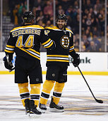 Dennis Seidenberg congratulates Patrice Bergeron of the Boston Bruins after he scored a goal against the Tampa Bay Lightning during the third period...