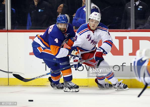 Dennis Seidenberg hangs on to Jesper Fast of the New York Rangers during the third period at the Barclays Center on October 4 2016 in the Brooklyn...