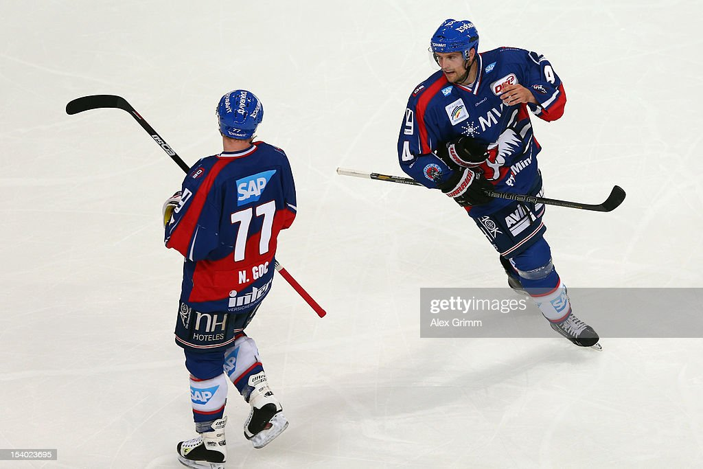Dennis Seidenberg (R) of Mannheim and Nikolai Goc of Mannheim during the DEL match between Adler Mannheim and Krefeld Pinguine at SAP-Arena on October 12, 2012 in Mannheim, Germany.