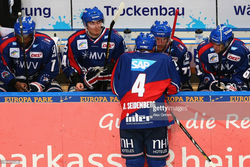 Dennis Seidenberg of Mannheim chats with team mates during the DEL match between Adler Mannheim and Krefeld Pinguine at SAP-Arena on October 12, 2012 in Mannheim, Germany.