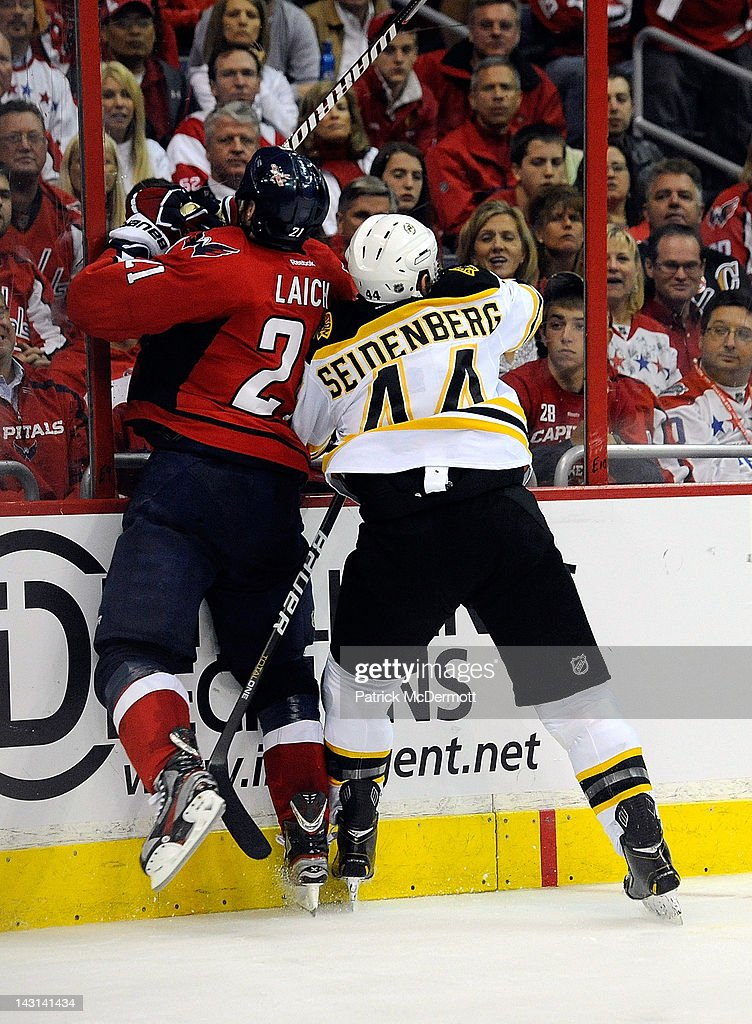 <a gi-track='captionPersonalityLinkClicked' href=/galleries/search?phrase=Dennis+Seidenberg&family=editorial&specificpeople=204616 ng-click='$event.stopPropagation()'>Dennis Seidenberg</a> #44 of the Boston Bruins and <a gi-track='captionPersonalityLinkClicked' href=/galleries/search?phrase=Brooks+Laich&family=editorial&specificpeople=554432 ng-click='$event.stopPropagation()'>Brooks Laich</a> #21 of the Washington Capitals battle for the puck during Game Four of the Eastern Conference Quarterfinals during the 2012 NHL Stanley Cup Playoffs at Verizon Center on April 19, 2012 in Washington, DC.