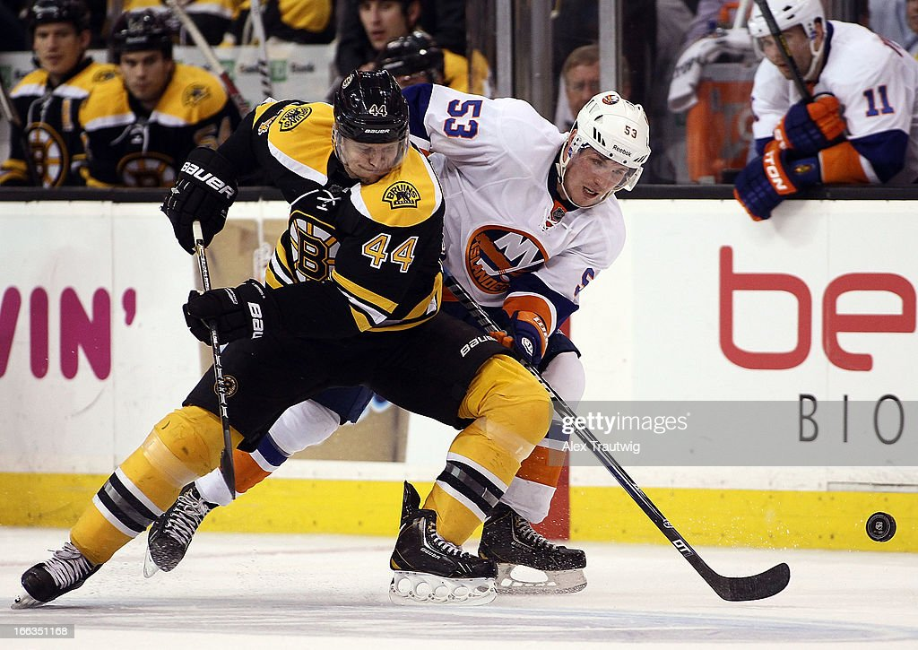 <a gi-track='captionPersonalityLinkClicked' href=/galleries/search?phrase=Dennis+Seidenberg&family=editorial&specificpeople=204616 ng-click='$event.stopPropagation()'>Dennis Seidenberg</a> #44 of the Boston Bruins and <a gi-track='captionPersonalityLinkClicked' href=/galleries/search?phrase=Casey+Cizikas&family=editorial&specificpeople=4779392 ng-click='$event.stopPropagation()'>Casey Cizikas</a> #53 of the New York Islanders battle for the puck at the TD Garden on April 11, 2013 in Boston, Massachusetts. The Islanders defeated the Bruins 2-1.