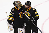 Dennis Seidenberg of the Boston Bruins and Tuukka Rask celebrate after defeating the Pittsburgh Penguins 51 at TD Garden on February 24 2016 in...