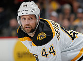 Dennis Seidenberg of the Boston Bruins awaits a face off against the Colorado Avalanche at Pepsi Center on January 21 2015 in Denver Colorado The...
