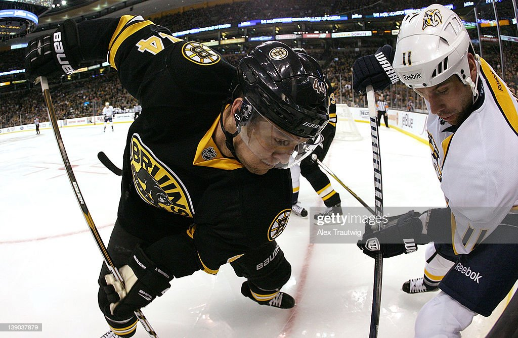 Dennis Seidenberg of the Boston Bruins battles in the corner with David Legwand of the Nashville Predators at TD Garden on February 11 2012 in Boston...