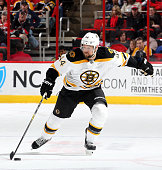 Dennis Seidenberg of the Boston Bruins carries the puck during their NHL game against the Carolina Hurricanes at PNC Arena on March 29 2015 in...