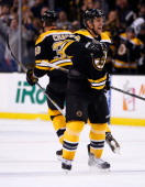 Dennis Seidenberg of the Boston Bruins celebrates following the gamewinning goal by teammate Zdeno Chara in the third period against the Pittsburgh...