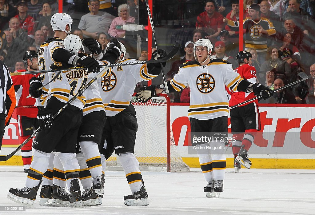 <a gi-track='captionPersonalityLinkClicked' href=/galleries/search?phrase=Dennis+Seidenberg&family=editorial&specificpeople=204616 ng-click='$event.stopPropagation()'>Dennis Seidenberg</a> #44 of the Boston Bruins celebrates his game-winning goal against the Ottawa Senators with teammates <a gi-track='captionPersonalityLinkClicked' href=/galleries/search?phrase=Zdeno+Chara&family=editorial&specificpeople=203177 ng-click='$event.stopPropagation()'>Zdeno Chara</a> #33 and <a gi-track='captionPersonalityLinkClicked' href=/galleries/search?phrase=Tyler+Seguin&family=editorial&specificpeople=6698848 ng-click='$event.stopPropagation()'>Tyler Seguin</a> #19 of on March 21, 2013 at Scotiabank Place in Ottawa, Ontario, Canada.