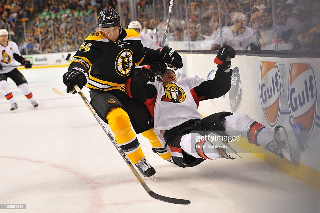 <a gi-track='captionPersonalityLinkClicked' href=/galleries/search?phrase=Dennis+Seidenberg&family=editorial&specificpeople=204616 ng-click='$event.stopPropagation()'>Dennis Seidenberg</a> #44 of the Boston Bruins checks against a player of the Ottawa Senators at the TD Garden on February 28, 2013 in Boston, Massachusetts.