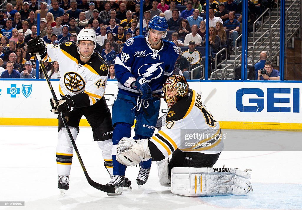 Dennis Seidenberg #44 of the Boston Bruins fights for position with <a gi-track='captionPersonalityLinkClicked' href=/galleries/search?phrase=Benoit+Pouliot&family=editorial&specificpeople=879830 ng-click='$event.stopPropagation()'>Benoit Pouliot</a> #67 of the Tampa Bay Lightning during the third period of the game at the Tampa Bay Times Forum on February 21, 2013 in Tampa, Florida.