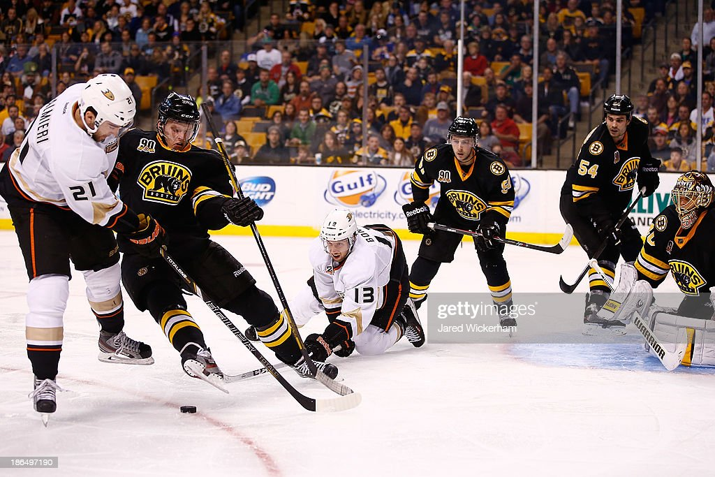 <a gi-track='captionPersonalityLinkClicked' href=/galleries/search?phrase=Dennis+Seidenberg&family=editorial&specificpeople=204616 ng-click='$event.stopPropagation()'>Dennis Seidenberg</a> #44 of the Boston Bruins is tripped up by <a gi-track='captionPersonalityLinkClicked' href=/galleries/search?phrase=Nick+Bonino&family=editorial&specificpeople=5805660 ng-click='$event.stopPropagation()'>Nick Bonino</a> #13 of the Anaheim Ducks in front of the puck in the second period at TD Garden on October 31, 2013 in Boston, Massachusetts.