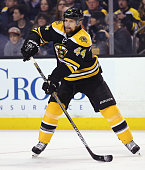 Dennis Seidenberg of the Boston Bruins looks for a pass during the second period against the Tampa Bay Lightning at TD Garden on March 12 2015 in...