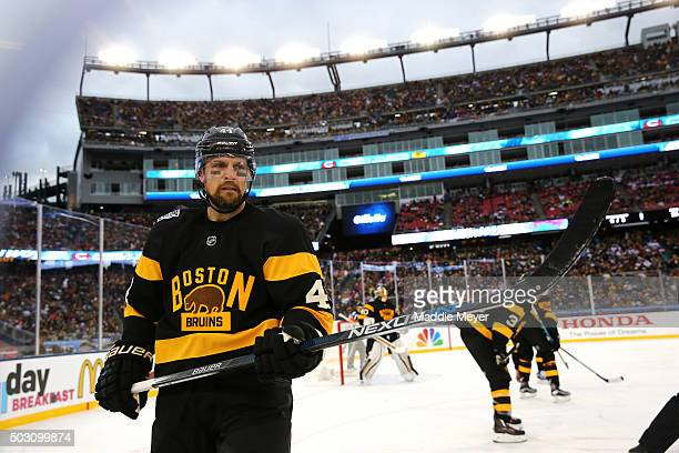 Dennis Seidenberg of the Boston Bruins looks on in the second period against the Montreal Canadiens during the 2016 Bridgestone NHL Winter Classic at...