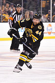 Dennis Seidenberg of the Boston Bruins shoots the puck against the Buffalo Sabres at the TD Garden on December 26 2015 in Boston Massachusetts