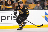Dennis Seidenberg of the Boston Bruins skates during warm ups prior to the game against the Detroit Red Wings at the TD Garden on October 14 2013 in...