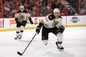 Dennis Seidenberg of the Boston Bruins skates in this 600th career NHL game during a game against the Ottawa Senators at Canadian Tire Centre on...
