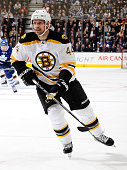 Dennis Seidenberg of the Boston Bruins skates up the ice against the Toronto Maple Leafs during NHL game action November 12 2014 at the Air Canada...
