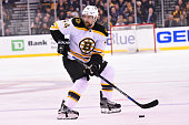 Dennis Seidenberg of the Boston Bruins skates with the puck against the Los Angeles Kings at the TD Garden on February 9 2016 in Boston Massachusetts