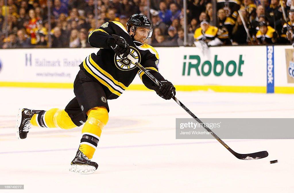 Dennis Seidenberg #44 of the Boston Bruins takes a shot against the New York Rangers during the season opener game on January 19, 2013 at TD Garden in Boston, Massachusetts.