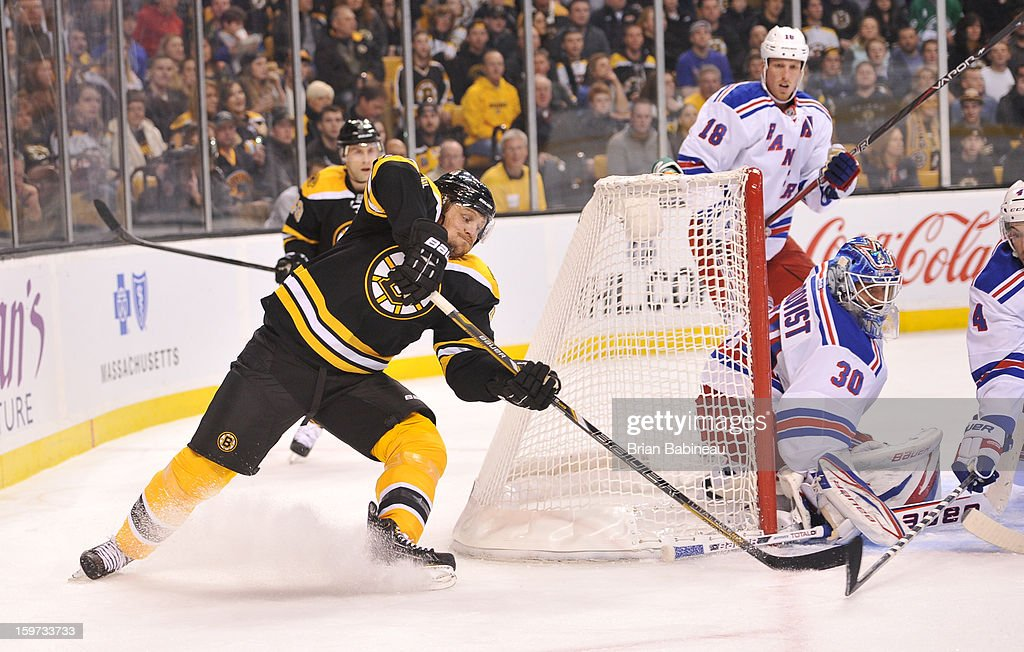 Dennis Seidenberg #44 of the Boston Bruins tries to put the puck in the net against the New York Rangers at the TD Garden on January 19, 2013 in Boston, Massachusetts.