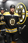 Dennis Seidenberg of the Boston Bruins walks to the ice for warm ups before the game against the Detroit Red Wings at the TD Garden on December 29...