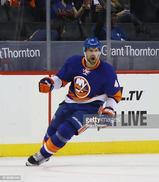Dennis Seidenberg of the New York Islanders celebrates his first period goal against the Arizona Coyotes at the Barclays Center on October 21 2016 in...