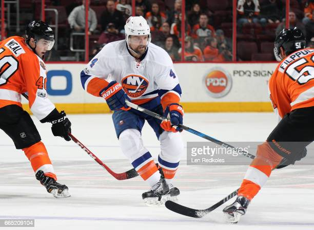 Dennis Seidenberg of the New York Islanders in action against Jordan Weal and Valtteri Filppula of the Philadelphia Flyers on March 30 2017 at the...