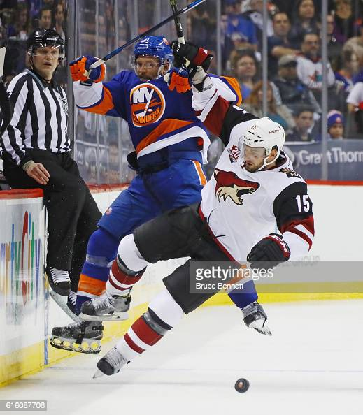 Dennis Seidenberg of the New York Islanders is hit by Brad Richardson of the Arizona Coyotes during the second period at the Barclays Center on...