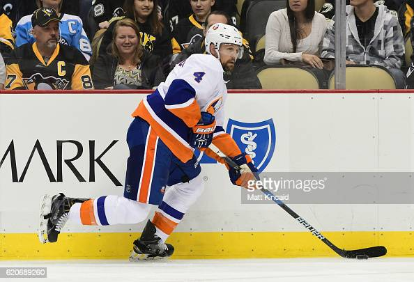 Dennis Seidenberg of the New York Islanders skates with the puck against the Pittsburgh Penguins at PPG PAINTS Arena on October 27 2016 in Pittsburgh...