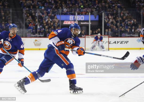 Dennis Seidenberg of the New York Islanders takes a slapshot against the New York Rangers at the Barclays Center on February 16 2017 in the Brooklyn...