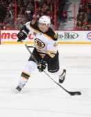 Dennis Seidenberg the Boston Bruins fires a snapshot against the Ottawa Senators in his 600th career NHL game being played at Canadian Tire Centre on...