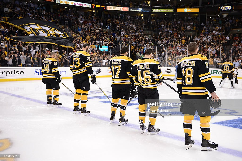 Dennis Seidenberg #44, Zdeno Chara #33, Milan Lucic #17, David Krecji #46 and Nathan Horton #18 of the Boston Bruins stand on the ice for the National Anthem against the Chicago Blackhawks in Game Four of the Stanley Cup Final at TD Garden on June 19, 2013 in Boston, Massachusetts.