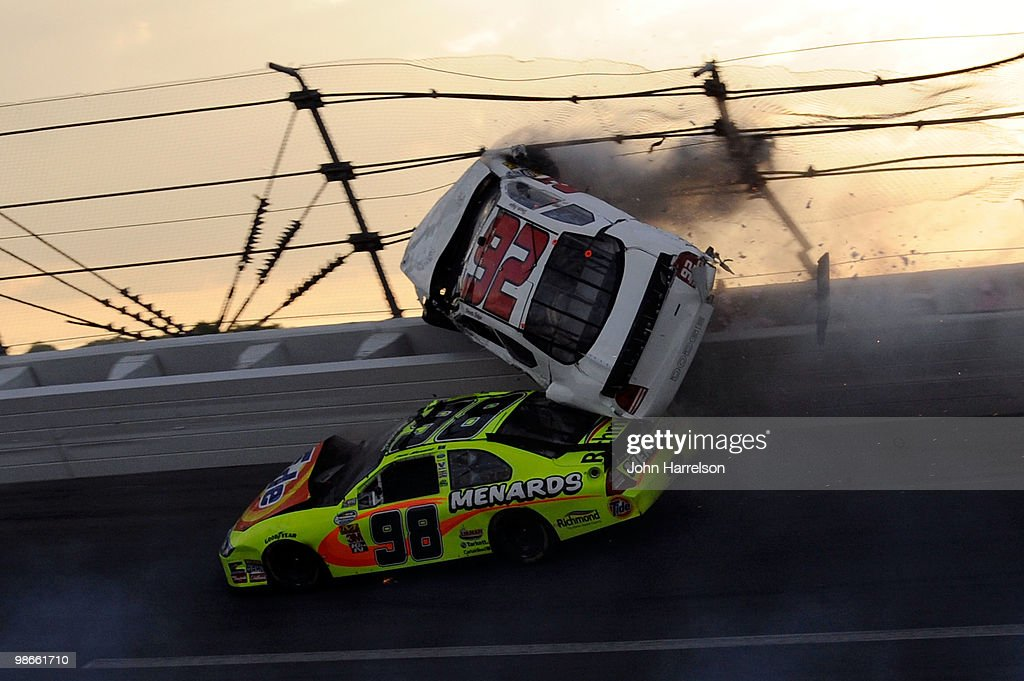 Dennis Setzer driver of the KAutomotive Dodge goes airborn over Paul Menard driver of the Tide/Menards Ford after an incident on track during the...