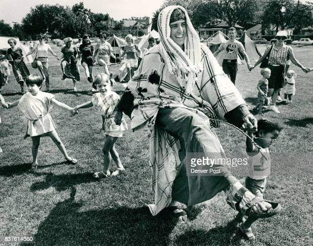 Dennis Shull who played a beggar danced the Hora with youngsters during the final day of a Biblical Marketplace experience as part of a summer...